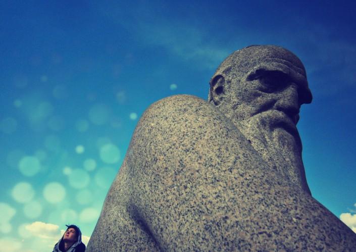 Pensive statue and person
