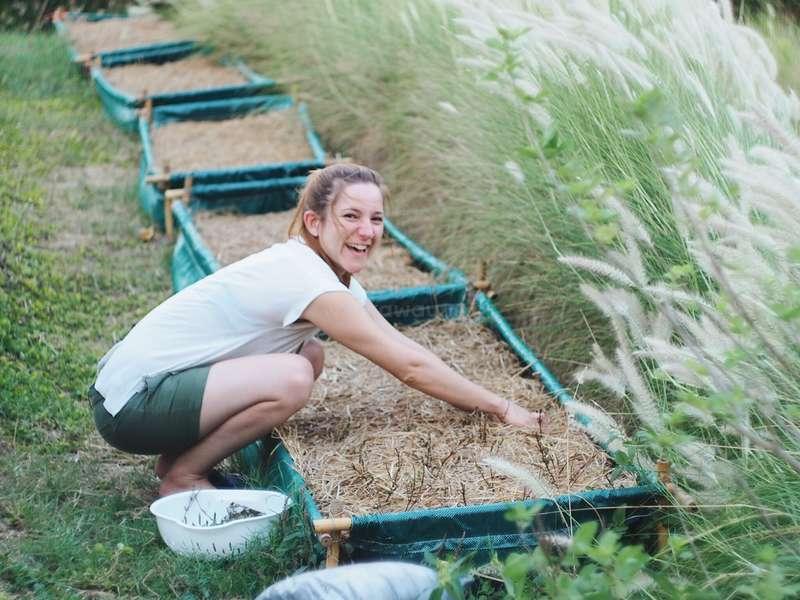 female-traveller-on-farm-planting-in-thailand